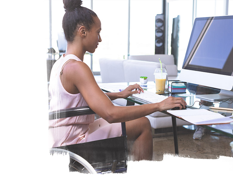 Young disabled businesswoman working on a computer